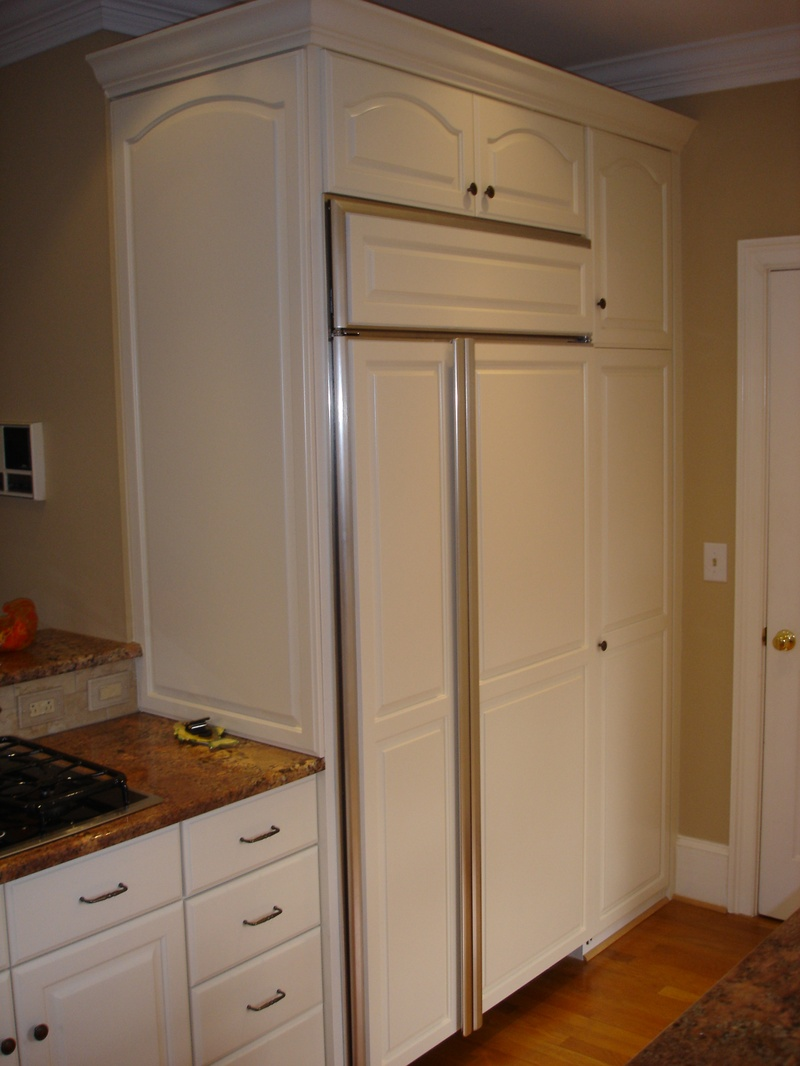 New pantry and built in fridge with panels for Pre manufactured cabinets